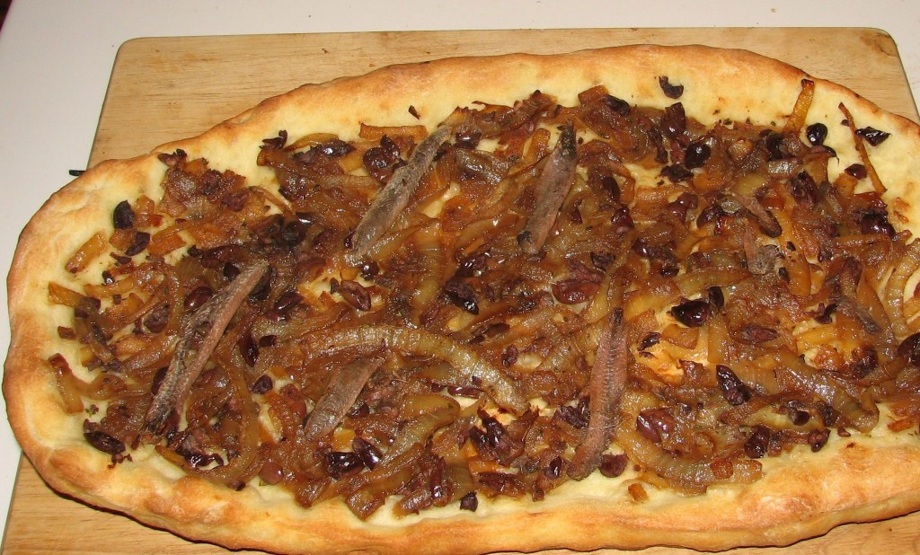Pissaladiere with rough cross-hatching of anchovies, Nicoise olives